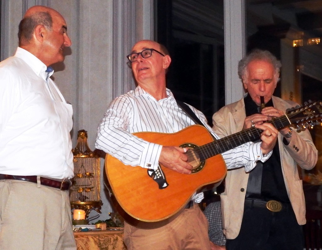 At home with John Heller (on guitar), the power behind the exhibition. David Amram (right)